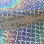 mermaid-scale-fabric-fish-tale-foil-2-way-stretch-jersey-material-112cm-wide-silver-hologram-scales-on-white-594bfa561.jpg