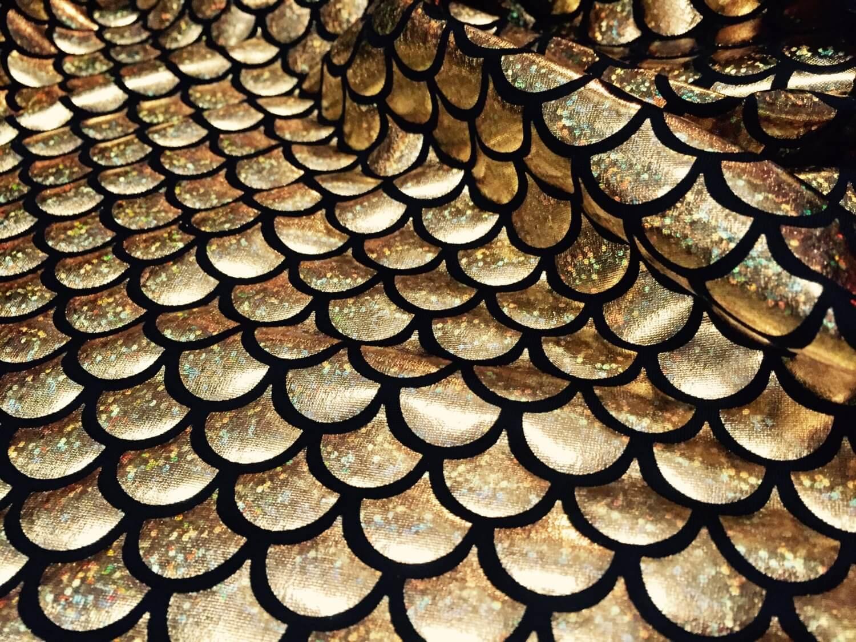mermaid-scale-fabric-fish-tale-foil-2-way-stretch-lycra-spandex-material-150cm-wide-gold-hologram-scales-on-black-5b6b63af1.jpg